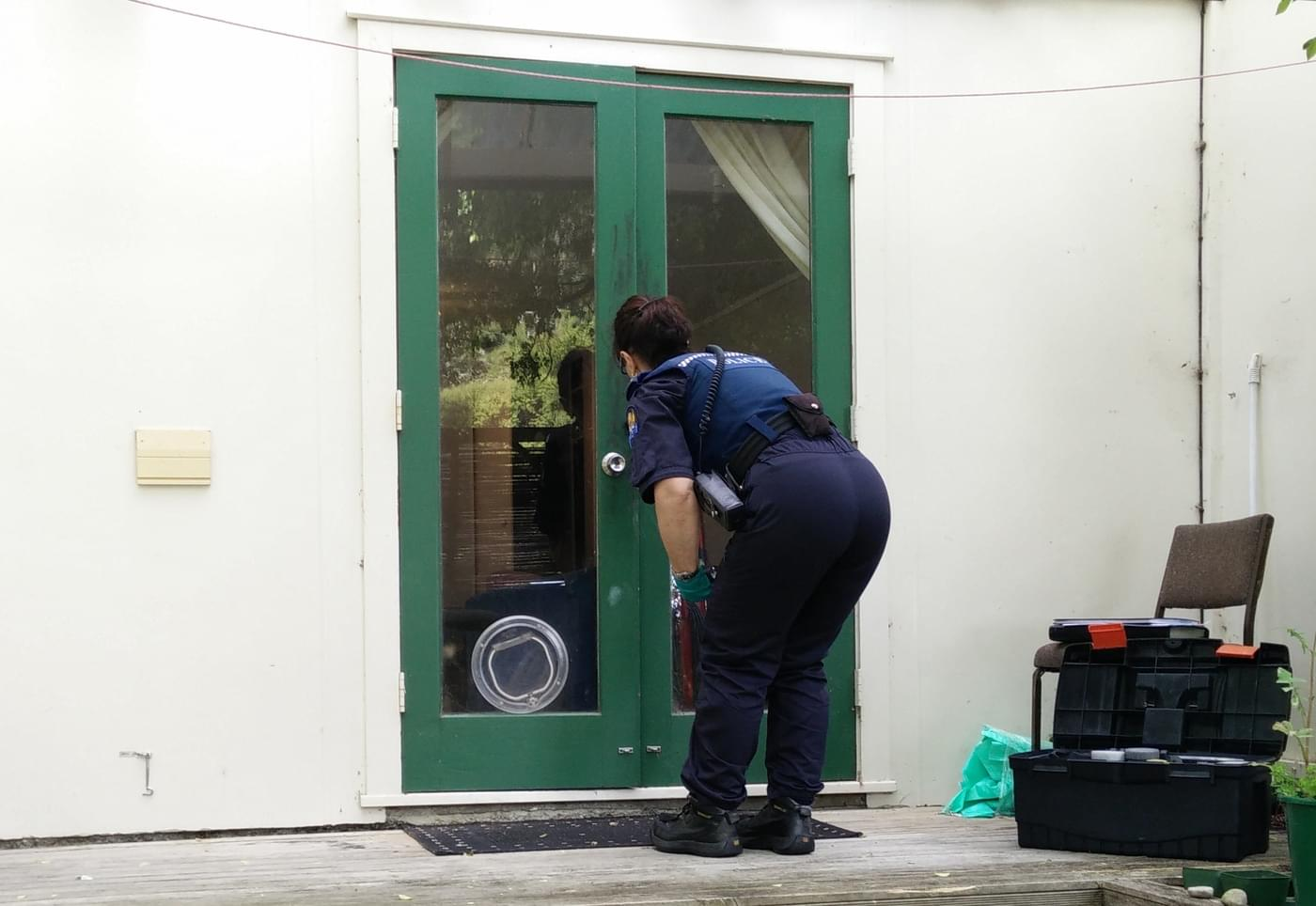 Police Officer Investigating a Break-in at My Flat in Wellington, New Zealand